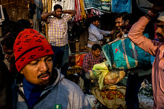 Men and Flowers-20180217-DSC_1207 (thomschphotography3) Tags: men flowers shadows light india kolkata asia streetphotography flowermarket market people faces