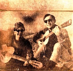 Scan of a 50 year old xerox photocopy of a Kodak Instamatic snapshot of me and a good friend pretending to be folksingers of that era. (A CASUAL PHOTGRAPHER) Tags: photocopy johnbeck johnlbeck guitar instamatic xerox