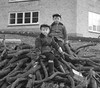 Not for the bonfire (theirhistory) Tags: children boys kids wood pile sticks trees cap jacket wellies rubberboots