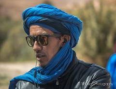"Berber merchant   TrinDiego (TrinDiego) Tags: morocco trindiego berber blue shades reflection todra gorge todragorge almamlakahalmaghribiyah ""western kingdomالمَغرِبⵍⵎⵖⵔⵉⴱ تودراالخانق highatlas highatlasmountains todghagorge ⵜⵉⵣⵉⵏⵜⵓⴷⵖⴰ مضيقتودغا الاطلسالكبير hautatlas ⴰⴷⵔⴰⵔⵏⴷⵔⵏ northafrica africa kingdomofmorocco ⵜⴰⴳⵍⴷⵉⵜⵏⵍⵎⵖⵔⵉⴱ المملكةالمغربية almaġrib portrait colourful colour people"