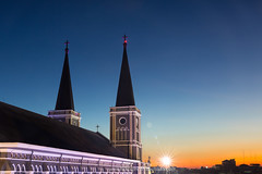 The Chanthaburi Cathedral and beautiful sky at dusk. (baddoguy) Tags: alley ancient civilization architecture awe beauty in nature building exterior built structure cathedral catholicism christmas decoration lights church closeup color image copy space diminishing perspective dramatic sky dusk electric lamp famous place gothic style happiness hope concept horizontal igniting lighting equipment local landmark majestic national no people part of photography point view praying religion road roof spiked street sunset thai culture thailand travel destinations twilight