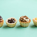 Front view of mini cake tarts. Desserts. Blue background.jpg