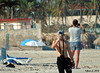 Phones (Jean S..) Tags: sunshine sunny sun phones men beach candid streetphotography