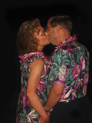 Jean Yves Pantaloni (jeanyvespantaloni0) Tags: 40 50 age aged anniversary blouse casual couples curly dress dressy female floral flowers glasses hair hands happy hawaii hawaiian hold holding honey honeymoon human husband kiss kissing lady leis love male man matching maui men middle middleage middleaged moon navy old older outfits people person pose posing print shirts smile smiling smooch smooching stand standing together tourism tourists travel traveling tropical tropics two vacation vacationers vacationing wife woman women year jean yves pantaloni