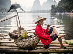 Smoke 2 (lc99photography) Tags: smoke pipe pipesmoking cormorant cormorantfisherman cormorantfishing raft bambooraft landscape nature china travel water lijiang liriver bird mountains karst karstformation reflections guilin
