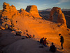 Delicate Arch Gives Audience (xjblue) Tags: 2017 archesnationalpark southernutah utah canyoneering desert hiking trip naturalarch sandstone redrock scenic landscape crowd audience sunset delicate arch moab photography olympus omdem1 mzuiko17mmf18
