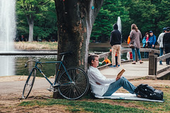 ride/read (mntkondr) Tags: japan tokyo yoyogi park bicycle man tree read book fujifilm sitting xh1