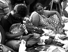 Searching for humanity (magiceye) Tags: street streetphoto streetportrait monochrome blackandwhite bnw mumbai fleamarket india