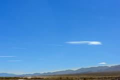 20180316_Death_Valley_100 (petamini_pix) Tags: california deathvalley deathvalleynationalpark desert landscape mountains westsideroad clouds lenticularclouds plane jetplane contrail