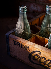 Drink Coca... (Jeffrey Sullivan) Tags: bottle light coke cocacola building interior access bodie state historic park easternsierra night landscape photography abandoned wild west mining ghost town monocounty bridgeport california unitedstates usa canon eos 6d photo copyright 2016 jeff sullivan june