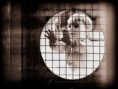 "Mind""s Captive (Kris Lantijn) Tags: boy grill circle monochrome hands child outside"