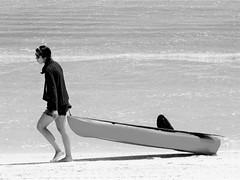 Pulling a kayak (thomasgorman1) Tags: kayak bw monochrome boat beach sand shore canon baja mx mexico resort candid woman sunglasses street streetphotos streedtshots outdoors recreation