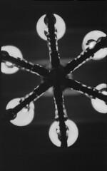 P56-2017-005 (lianefinch) Tags: blackandwhite blackwhite noirblanc noiretblanc bw nb argentique argentic analogique monochrome contraste contrast chiaroscuro clair obscur intérieur indoor lustre light chandelier lumière dragon