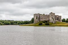 Carew Castle (Keith in Exeter) Tags: carew castle pembrokeshire pond lake wales ruins fort tower wall stonework watergrass tree woodland landscape