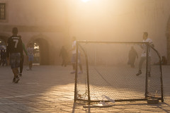 Playing football (Tim&Elisa) Tags: essaouira canon sunset city mogador morocco goal players