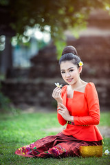 Happy young asian woman holding flower and sitting down on grass in the park (Pramote Polyamate) Tags: woman asian flower vietnam girl geisha beautiful portrait happy beauty people female asia background japanese young traditional vintage hair nature green outdoor active field costume grass pretty black running fresh person spring white yellow summer dress old culture garden happiness meadow laos thailand