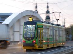 Tramwaj (maciey24) Tags: tramwaj droga road jezdnia ulica street tram tramway most bridge poznań motion ruch pojazd vehicle moving public transport komunikacja miejska 12 twelve green zielony żółty yellow