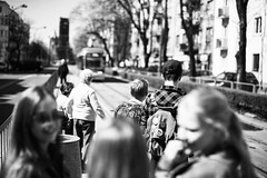 Backpacks and Blue Jeans 233.365 (ewitsoe) Tags: 50mm canon cityscape eos6dii ewitsoe spring street sunny travel warm warszawa erikwitsoe poland streetphotography urban warsaw wawa kids children tram city ochota headingtoschool monochrome bnw backandwhite