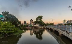 Reflections from afar (Rakuli) Tags: ifttt 500px neighbourhood water canal sunset pink reflections bridge traffic shacks shanties saigon vietnam