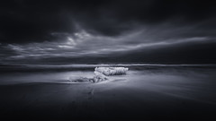 Kinda Blue ~ Ice Rising (Mabry Campbell) Tags: 17mm diamondbeach europe houstonphotographer iceland jokulsarlon jökulsárlón scandinavia southiceland southerniceland beach berg bergs blue coast coastal commercialphotography dark fineartphotographer fineartphotography ice icebergs iceberg image le longexposure monochrome moody nopeople ocean photo photograph photographer photography purple seascape selenium sunset waves f10 mabrycampbell april 2013 april142013 201304140h6a0706 130sec 100 ef1740mmf4lusm