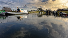Afternoon Reflections (Alfred Grupstra) Tags: nauticalvessel water harbor river transportation reflection pier outdoors moored nature commercialdock jetty netherlands canal sky europe cloudsky sea nopeople modeoftransport