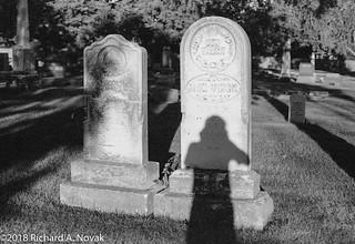 Elon Virgil and wife gravestones, shadow