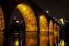 Minneapolis, Minnesota: Below the Stone Arch Bridge 1 (rocinante11) Tags: arch bridge minneapolis minnesota downtown skyline water reflection city longexposure timesexposure ambient ambientlight canoneos5dmarkii ef2470mmf28lusm guthrietheater gold