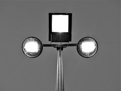 P10122621 (mathiasmanstrup) Tags: light urban robot face eyes street sci fi architecture space electricity bulb bulbs grey black white square circle 3 4 three four pole stick shining shiny atachment unity trinity symetri geometri flash flashing bright blinding looking bending art noir dark clean photo photography sky wallpaper background elegant beauty simple simplicity construction technology watch guardian fork evil devil spotlight fallos penetration stab root life death center metal steel penis balls shaft fertility graphic