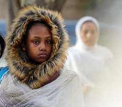 The lioness and her ghosts (ybiberman) Tags: israel jerusalem ethiopianchurch ethiopiancathedral girl adolescent raincoat hat veil earring portrait candid streetphotography white people lent firstfriday prayer