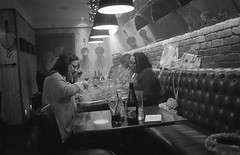 Friends enjoy a meal, searing steaks on hot stones at their table. Film 83 (4) (richardhunter3) Tags: olympus om1 ilford hp5 35mm pushed 800 film black white bw steak meal friends restaurant london enjoy happy smoke