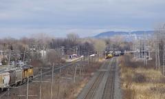 UP and CSX power about to meet (Michael Berry Railfan) Tags: cp canadianpacific cp332 train freighttrain graintrain vaudreuilsub kingstonsub pointeclaire montreal quebec cn327 csx csxt ac4400cw ge generalelectric csxt523 csxt4071 sd403 emd up5554 up5552