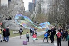 Central Park Dream (Anne Marie Clarke) Tags: bubbles easter park centralpark city sunday flickrfriday dream children rocks trees apparition ghost lateafternoon newyork landscape bubblescape 7dwf