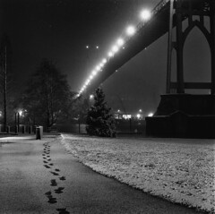 Leaving the St. Johns Bridge (Zeb Andrews) Tags: hasselblad film kodaktrix stjohnsbridge snowy night urban city bridge blackwhite 6x6 mediumformat portland oregon pacificnorthwest nighttime winter