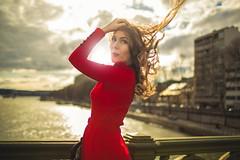 Sarah on the Mirabeau Bridge (François Escriva) Tags: red lady blogger bridge paris france mirabeau dress wind sun light hair buildings seine river fashion