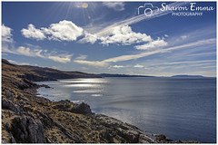 The Coastline of Loch Slapin (Sharon Emma Photography) Tags: sunshine sunrays sunglare kilbride lochslapin mountain strathairdpeninsula beinnnacaillich broadford thegardenofskye isleofskye skye skai anteileansgitheanach eileanacheò skíð cuillins oldwoman saucymary norwegianprincess thebeinn redhills redcuillin snow snowcappedmountains iconic mountains rocky water loch sky clouds dramatic dramaticlandscape peninsula innerhebrides scotland scottishhebrides pictureperfect picturesque view nature naturalworld wildlife wild ngc beautiful pretty ideal stunning peaceful nikon nikond7200 d7200 sharonemmaphotography sharongoldring sharonemmagoldring sharondowphotography sharondow february2018 2018 holiday travelling lensflare