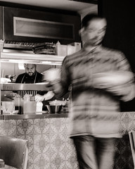 Fast Food (raymorgan4) Tags: fast food lunch meal society standard cardiff waiter serving chef fries chips soup sandwich wales blackandwhite slow shutter speed fujifilm fujifilmx100f fujifilmglobal monochrome cafe restaurant
