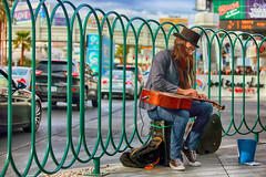 Playing Jeff Healey Style (Ian Sane) Tags: ian sane images playingjeffhealeystyle lap guitar playing performing busker busking candid street photography las vegas strip nevada bokeh wednesday canon eos 5ds r camera ef70200mm f28l is usm lens