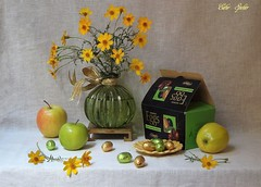 Easter Sunday. (Esther Spektor - Thanks for 12+millions views..) Tags: stilllife naturemorte bodrgon naturezamorta stilleben naturamorta composition creativephotography art spring easter sunday tabletop bouquet flowers fruit apple candy eggs box vase saucer stand ribbon bow glass ceramics metal ambientlight yellow green white golden black estherspektor sony