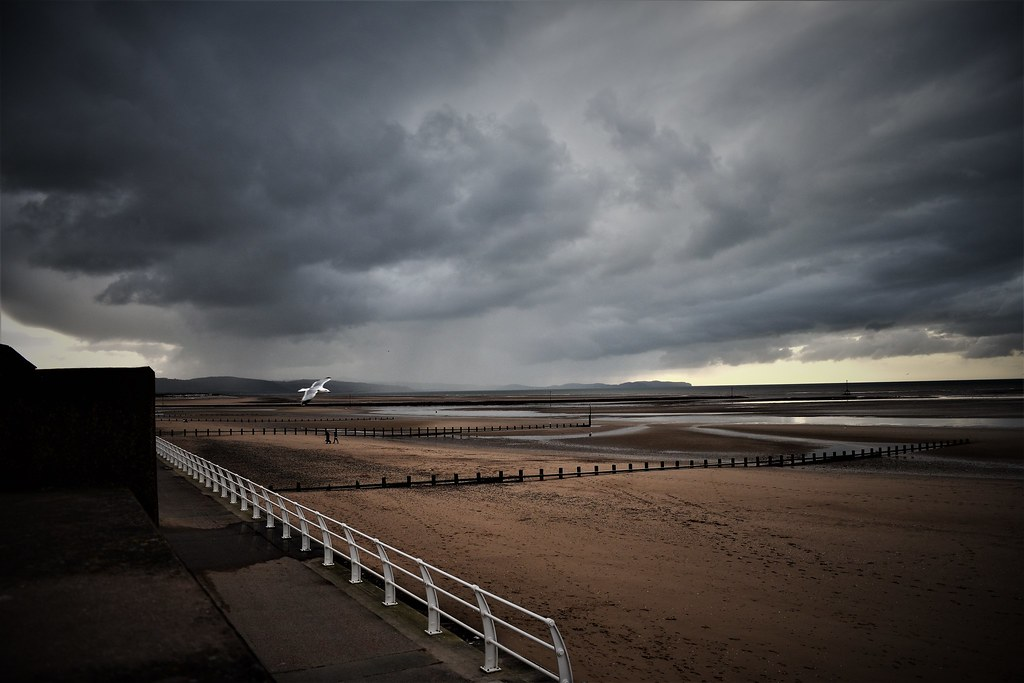 Looming clouds over Welsh coast