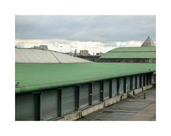 Grève (hélène chantemerle) Tags: hangars bâtiments vide fermés ciel nuages vert sheds buildings empty closed strike sky cloudy green