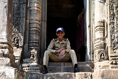 A Smile Makes All The Difference (D. R. Hill Photography) Tags: cambodia siemriep angkorwat angkor wat temple portrait man person police smile happy travel nikon nikond750 d750 nikon50mmf14g 50mm primelens fixedfocallength