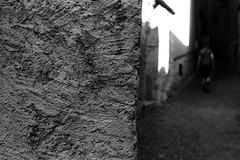 Light wedge (Leica M6) (stefankamert) Tags: stefankamert street wall light wedge noir noiretblanc blackandwhite blackwhite bw baw analog film grain lakecomo people blur leica m6 leicam6 ilford fp4