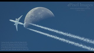 Cathay Pacific Airbus A350 with contrails, crosses the Moon