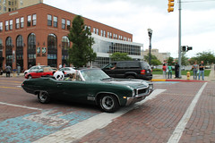 Gran Sport, Al Fresco (Flint Foto Factory) Tags: flint michigan genesee county urban city summer august 2017 home town annual backtothebricks car festival show week downtown saginawst firstst intersection wadetrim building 1968 buick gransport gs400 convertible 2454 produced moving motion inmotion rolling cruise green generalmotors gm abody intermediate restyled redesigned midsize muscle drop soft top brick street farmersmarket classic vintage stuffed toy panda bear reatta red