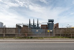 Power Spikes (Number Johnny 5) Tags: lines tamron d750 landscape industrial space mundane shapes yellow substation urban imanoot banal power walls double 2470mm electricity railings documenting signs johnpettigrew nikon