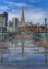 Boardwalk (Gunn Shots.) Tags: pier7 sanfrancisco puddle boardwalk transamericapyramid rain shine rainandshine hdr hff fisherman streetlamp leadinglines reflection fence railing embarcadero bench cityscape
