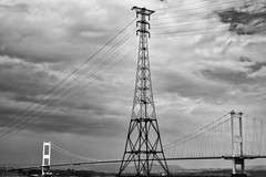 Electricity 7 (FTonyC) Tags: slta99v blackandwhite monochrome electricity riversevern bridge pylon clouds