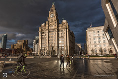 A Waterfront Setting (alundisleyimages@gmail.com) Tags: liverpool pierhead waterfront architecture liverbuilding cunardbuilding ferryterminal bicycle cyclist pedestrians people public clouds weather portsandharbours merseyside stormy england uk paving