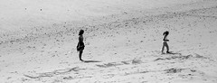 Message in the sand (Andy Sut) Tags: sea people motheranddaughter lookhereandy france letters writing message sand shore bw blackandwhite monochrome beach