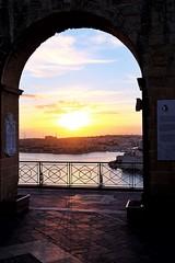 Valletta Dawn (Douguerreotype) Tags: light arch fort city cityscape sunrise malta architecture valletta urban water